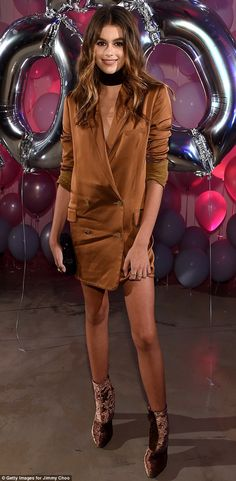 Cool neutrals: Kaia Gerber, 15, paired her Zimmermann coat dress with a pair of brown velv...