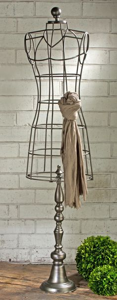Features:  -Industrial style body form.  -Antiqued finish.  -Made of metal.  -Great for hanging scarves.  Product Type: -Bust.  Style: -Industrial.  Subject: -Home decor and furniture.  Finish: -Paint