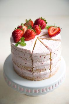 This strawberry lemon olive oil cake is our favorite dessert recipe of the summer. This recipe is easy to follow for a cake that's as delicious as it is beautiful thanks to lightly layered buttercream frosting and fresh strawberries used to garnish the cake.