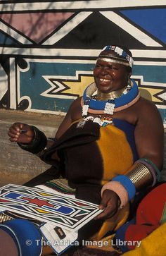 Photos and pictures of: Ndebele woman painting, Botshabelo Ndebele village, South Africa - The Africa Image Library African Patterns, Africa Art, World Of Color, Woman Painting, South Africa, Pictures, Photos, The Past, Industrial