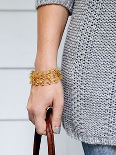 How to make a safety-pin bracelet.