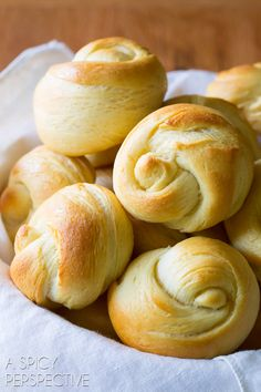 The Best Yeast Rolls Recipe Ever - Light, airy, and kissed with honey! An easy yeast roll recipe you'll make again and again. For holidays sides and sliders