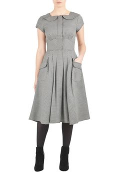 A playful mash-up of traditional elements and modern sensibilities is seen in our fit-and-flare dress crafted from textured houndstooth twill. Rounded flaps complement the fabric and highlight the square neckline and hidden front placket.