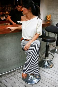 Love the striped maxi skirt and over-sized t-shirt combo with a thick leather belt to pull it all together.