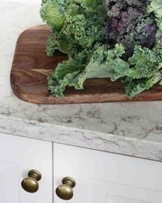Bold Brass - The brass hardware Kristin chose, like these Martha Stewart Living Goblet knobs in Bedford Brass, creates a nice pop of color against her white and neutral color palette.