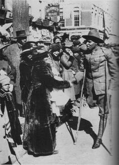 """Harlem """"Hellfighter"""" of the famed Regiment greets an admirer during a 1919 victory parade. Some African Americans became World War I soldiers. Among them were the first two Americans to win the Croix de Guerre, both infantrymen of the World War One, First World, African American History, Native American, American Soldiers, Interesting History, Military History, Military Photos, History Facts"""