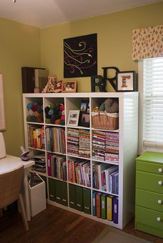 craft room. Shelves beside the window. I think this would look great next to the window...love the place for the yarn..but is it cat proof?