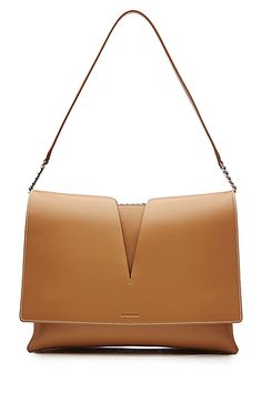 Impeccably+chic,+modern+and+versatile,+this+tan+brown+leather+shoulder+bag+from+Jil+Sander+is+a+smart+choice+that+you+can+use+season+after+season+-+a+handful+of+compartments+inside+makes+it+super+practical+too+#Stylebop