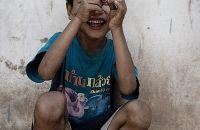 Perhaps a Laotian child wearing a Thai t-shirt.