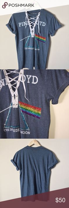 ✨ CUSTOM • Pink Floyd sparkle laced up choker tee • CUSTOM CUT V-NECK LACED UP CHOKER PINK FLOYD T-SHIRT  • BRAND NEW WITH TAGS! •  Perfect for any die hard Pink Floyd fan! the shirt itself is blue/gray in color but it BLINGS all different colors! the glitter affect is so beautiful but hard to capture in a photo :[ LOOKS AMAZING! and stylish to boot!   • SIZE SMALL  ☠️ BUNDLEtoSAVE ☠️ ACCEPTING OFFERS ☠️ 〰    #bling #sparkle #glitter #rainbow #pinkfloyd #rock #darksideofthemoon #choker…