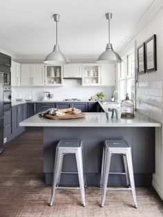 Gray is the new white when it comes to kitchen cabinets. Staying strong is mixing cabinet colors (shown here in gray and white).NEW LEAF KITCHENS offers unfinished doors and drawers so you can paint.
