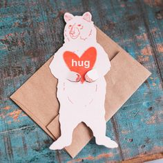 "What better way to say, ""be my valentine"" than with a bear hug. Spread the love and the hugs with this playful Grizzly Bear Card by Blackbird Letterpress. Her arms are die cut and ready to hold any sweet treasure."