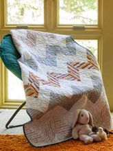 The next best thing to a hug, this quilt's magic comes from Daddy's work shirts.