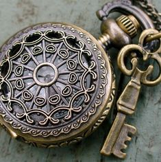 Steampunk pocket watch Necklace key pirate by UmbrellaLaboratory
