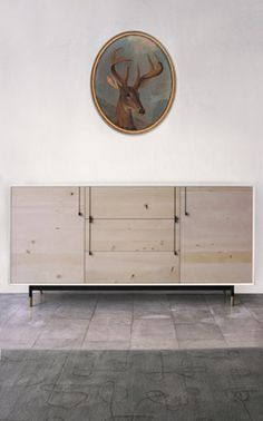 BDDW lake bureau white laquer exterior with holly and hand carved ebony handles, steel base and adjustable bronze feet