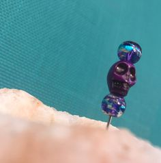 A personal favorite from my Etsy shop https://www.etsy.com/listing/522615377/purple-galaxy-beaded-skull-pipe-poker