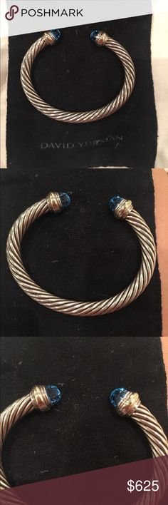 David Yurman 7MM Silver & 14k Cable Bracelet Topaz This is a beautiful David Yurman 7MM Cable bracelet with Blue Topaz stones. Received as a gift and worn once before deciding it was not my style! David Yurman Jewelry Bracelets