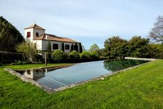 Home prices in northern Portugal fell by as much as 35 percent after the global real estate crisis of but have held steady in recent years. Global Real Estate, Modern Pools, Indoor Outdoor Living, House Prices, Ny Times, Acre, Swimming Pools, Portugal, Villa