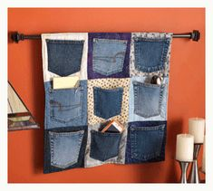 Need a cool way to recycle your old jeans? How about some extra storage? This denim pocket upcycle project at Cloth Paper Scissors is right up your alley. Recycled Denim, Recycled Crafts, Wooden Crafts, Artisanats Denim, Denim Purse, Jean Diy, Sewing Pockets, Diy Jeans, Denim Ideas