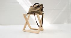 Hover X is a luggage rack created by two interlocking rectangular wood elements, which have strips of linen stretched between them. The design aims at effortless elegance, and high degree of functionality. Luggage Rack, Bucket Bag, Elegant, Wood, Bags, Design, Dapper Gentleman, Handbags, Roof Rack