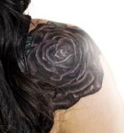 Kim Saigh's Purple Rose front shoulder tattoo