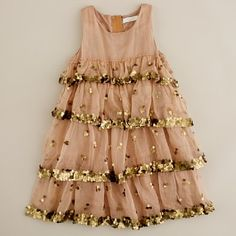 Girls' sequin enchant dress  J.Crew  $ 298.00 $ 239.99    Straight from the pages of a storybook. Allover tiers of ruffles and sequinscreate a romantic mix of textures and a whimsical effect. It's the dress every girl dreams of wearing. Cotton. Sleeveless. Zip closure. Cupcake skirt shape. Fully lined. Falls to knee. Import. Dry clean.