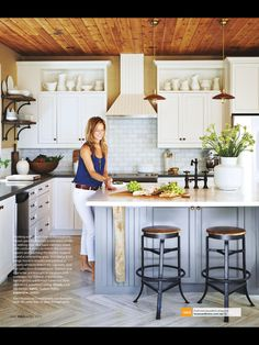 White kitchen. Subway tile. White cabinets. Black countertop. House & Home Magazine.