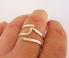 Modern Twist Simple Ring -  Hammered Sterling Silver Ring - Contemporary Wire Wrap Ring. $42.00, via Etsy.