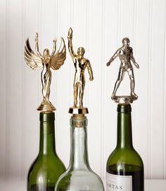 Trophy Wine Stoppers - First drill about halfway down into a cork. Then twist the topper off a trophy. Oh wow, there's a screw built in there. Apply superglue to the trophy topper's base and screw and then twist them into the wine cork. Allow to dry before showing off to friends.