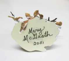 makers mark for Mary McGrath - signature Mary McGrath and year found on hand sculpted animal scenes