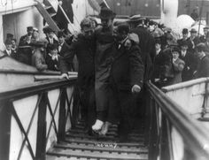 Loss of White Star Line's Olympic-class vessel RMS Titanic which struck an iceberg on 12 April 1912 on her maiden voyage. Surviving wireless operator, Harold Bride, feet bandaged, being carried up gangway, New York. Disaster (Photo by Universal History Archive/Getty Images)