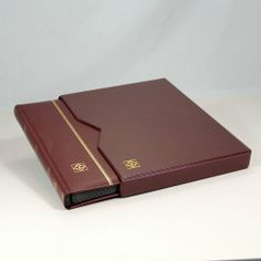 """Lighthouse 32-Black Page Stamp Stockbook LZS4/16K Burgundy by Lighthouse. $31.95. This stockbook is burgundy padded leather with gold lettering and features a double linen hinge binding. It comes in a leather slipcase. The exterior measures 9"""" x 12"""" (230 x 305mm). LZS4/16K Black pictured above."""