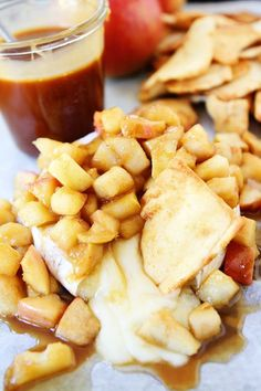 Baked Brie with Apples and Salted Caramel Recipe on twopeasandtheirpod.com The perfect party appetizer!