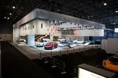 """Lincoln defined its space at the 2013 New York International Auto Show with a partial wall perforated with a logo-inspired pattern, a feature the company called the """"the Lincoln Lattice membrane."""" Exhibit Works engineered and fabricated the exhibit, and Imagination was the creative agency behind it. #booth #exhibit"""