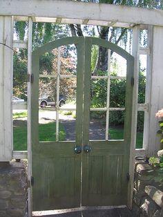 old doors made into a garden gate ...  Oooo ... I like!