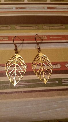 Check out this item in my Etsy shop https://www.etsy.com/listing/243776681/gold-color-leaf-earrings