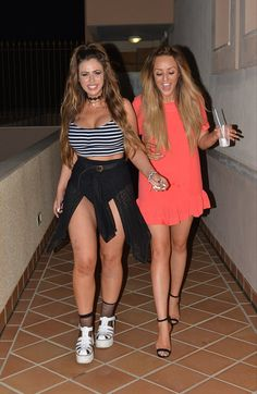 Nothing to hide: Holly Hagan ditches a skirt in favour for a string top and high-waisted p...