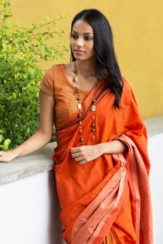 Blends of deep rust in combination with brown and beige form a rich shade of orange to give, as the name depicts the color of Rath Handun. Textured blouse and blocks of textures and colors in the fall compliments it.