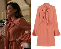 """1x05 Cristal Flores (Nathalie Kelley) wears this long sleeved pleated cuff tie neck coral colored dress in this episode of Dynasty, """"Company Slut"""". It is the Gucci Pussy-bow silk-georgette dress"""