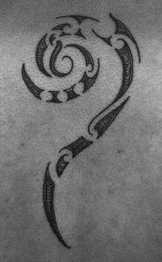 Maori koru tattoo