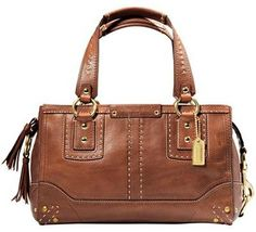 The Andrea Satchel, by Coach while no-longer available from the maker, can be found. Usually for around $350