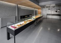 Colourful treats contrast with a black and grey interior at this patisserie.