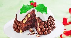 What a great idea this Chocolate Malteser Christmas Pudding Cake is and it will look amazing on your Christmas Table!  	535g packet rich chocolate cake mix 	ingredients to prepare cake as directed 	453g tub ready made chocolate frosting 	1/2 cup white choc bits 	2 x 280g packets of Maltesers 	500g packet ready made white fondant icing 	green food colouring 	a few Jaffas, to decorate