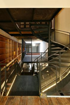 House N° 17 - The first floor which houses the public functions of this residence, is a continuous series of spaces that runs through to the back.  A few matters past the entry, a spiral staircase that extends to the topmost floor quickly provides a re-orientation along the vertical axis.  Thus upon entry, one can immediately sense the scale of the shop-house, comprehending it in terms of its depth and its height.