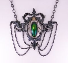 Jewels for Ghouls: Sterling Silver Baroque Necklace with Beetle in Resin by Metal Couture Jewelry. $3,500.