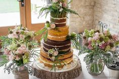 The wedding cake and bridal bouquets. Wedding flower designs at Kingscote Barn by Bristol florists, The Wilde Bunch Barn Wedding Flowers, Wedding Flower Design, Kingscote Barn, Florists, Bridal Bouquets, Bristol, Flower Designs, Wedding Cakes, Flower Drawings