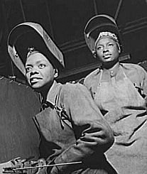 Image of Rosie broadens to embrace African-American women: Black women made up a large proportion of the female work force during World War II. They handled many technical and skilled jobs in America's war industries.