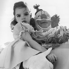 American actress and singer Liza Minnelli as a child in the arms of Bozo the Clown (Pinto Colvig) at a children's Easter party in Hollywood.