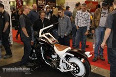 Eden (N.Y.) High School students discuss their Chopper Class Challenge build at the 2014 Donnie Smith Bike & Car Show.