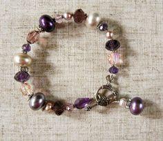 Vineyard Purple Bracelet with Pearl, Crystal, and Prism Glass  Materials: Pearl, Crystal, Prism Glass, Rhinestone, Sterling Silver Toggle